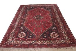 20th century Turkish wool small carpet with traditional geometric design in black and cream to a red