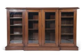 Late 19th/early 20th century break front bookcase with moulded edged top, four glazed doors,