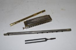 BOX CONTAINING A HOHNER MOUTH ORGAN AND OTHER METAL ITEMS