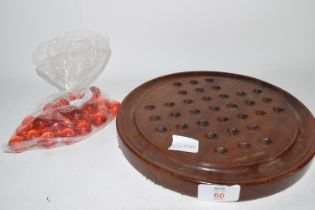 WOODEN BOARD WITH RED MARBLES