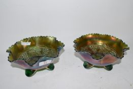 TWO CARNIVAL GLASS DISHES WITH A LEAF AND BERRY DESIGN, RAISED ON THREE FEET (2)