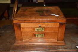 WELLINGTON STYLE OAK STATIONERY BOX, COMPRISING TWO DRAWERS BENEATH LIFT TOP SECTION, MOUNTED WITH