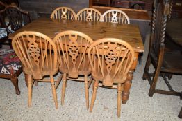 MODERN STAINED PINE RECTANGULAR DINING TABLE AND A SET OF SIX WHEEL BACK CHAIRS, THE TABLE APPROX