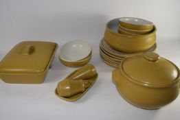 BOX CONTAINING DENBY DINNER WARES IN LIGHT BROWN OR BUFF GLAZE COMPRISING DINNER PLATES, BOWLS,