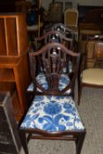 SET OF THREE DECORATIVELY CARVED SERPENTINE FRONT SHIELD BACK DINING CHAIRS, EACH WIDTH APPROX 52CM