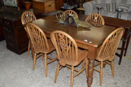 STAINED PINE RECTANGULAR DINING TABLE TOGETHER WITH SIX WHEEL BACK CHAIRS, APPROX 78 X 137CM