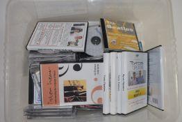 PLASTIC BOX CONTAINING DVDS