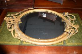 ORNATE GILT FRAMED MIRROR WITH HEAVILY CARVED DECORATION INCORPORATING TWIN CANDLE SCONCES AND