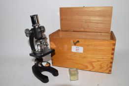 WOODEN BOX CONTAINING A MICROSCOPE WITH UP TO 500X MAGNIFICATION