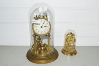 TWO CLOCKS IN GLASS DOMES