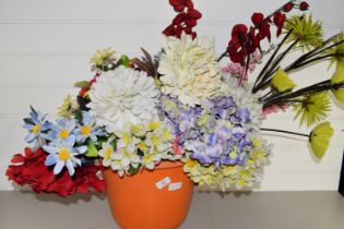 SPRAY OF ARTIFICIAL FLOWERS IN TERRACOTTA STYLE POT