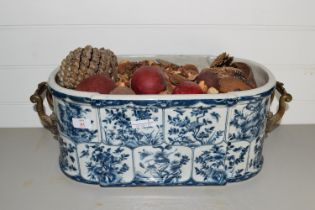 POTTERY BLUE AND WHITE DISH WITH METAL HANDLES CONTAINING PINECONES