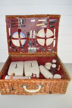 LARGE WICKER PICNIC BASKET WITH INTERIOR OF THERMOS FLASK AND VARIOUS TRAYS BY SIRRAM
