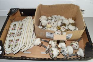 BOX CONTAINING DOOR PLATES AND HANDLES, ALL CERAMIC WITH FLORAL PRINTED DESIGNS