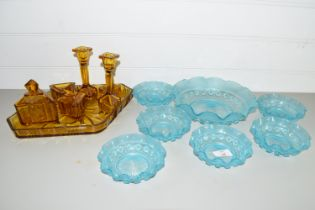 TRAY CONTAINING COLOURED GLASS ITEMS INCLUDING AMBER GLASS DRESSING TABLE SET AND BLUE GLASS BOWLS