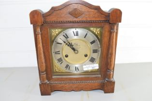 OAK MANTEL CLOCK WITH GILT DIAL WITH ROMAN NUMERALS