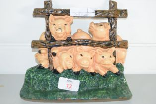 DOORSTOP MODELLED AS A FAMILY OF PIGS