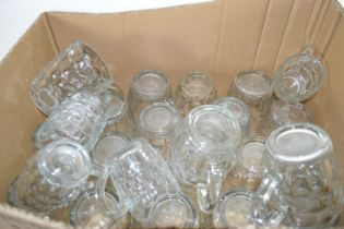 TRAY CONTAINING GLASS BEER MUGS