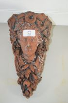 TERRACOTTA WALL BRACKET MODELLED AS THE HEAD OF A CLASSICAL LADY