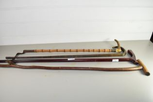 QTY OF WALKING CANES AND A BAMBOO RIDING WHIP