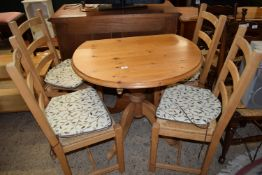 PINE CIRCULAR PEDESTAL FOLDING TABLE, DIAM APPROX 90CM TOGETHER WITH A SET OF MODERN RUSH SEATED