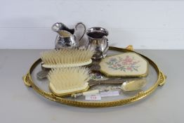SMALL GILT TRAY WITH VARIOUS ITEMS, HAIR BRUSHES, PLATED SPOON, JUG, SMALL TANKARD ETC