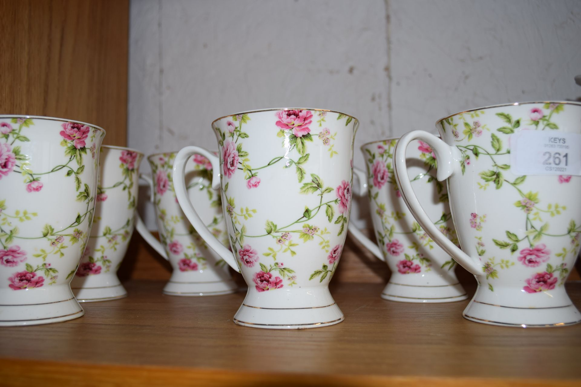 SET OF SIX FLORAL DECORATED MUGS BY CLAYRE & EEF