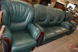 UPHOLSTERED LEATHER THREE PIECE SUITE COMPRISING SOFA, RECLINER CHAIR AND ARMCHAIR, THE SOFA