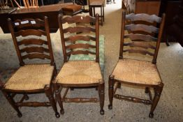 SET OF THREE CANE SEATED LADDERBACK CHAIRS