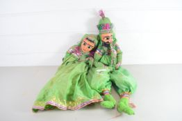 TWO PUPPETS IN GREEN DRESS