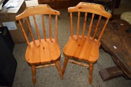 TWO MODERN VARNISHED PINE KITCHEN CHAIRS