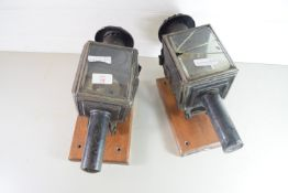 TWO VINTAGE CAR LAMPS ON WOODEN MOUNTS