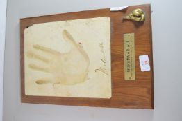 FACSIMILE OF MOHAMMED ALI'S HAND WITH PLAQUE BELOW
