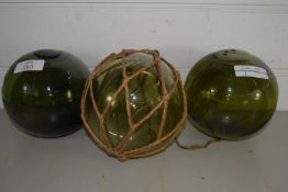 THREE GREEN GLASS BALLS