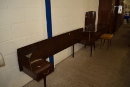 FIVE PIECE 1960S BEDROOM SUITE COMPRISING HEADBOARD/SIDE CABINET, DRESSING TABLE, STOOL AND TWO