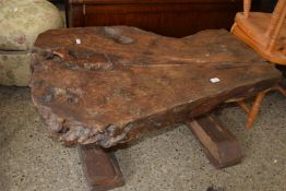 HEAVY JOINTED COFFEE TABLE, THE TOP FORMED FROM ONE SLICE WITH HEAVY JOINTED SUPPORTS, APPROX 107