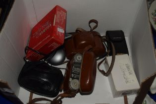 BOX CONTAINING CAMERA EQUIPMENT AND TWO CAMERAS INCLUDING A PAXETTE IN LEATHER CASE