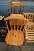 PAIR OF VARNISHED PINE KITCHEN CHAIRS