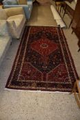 LARGE RUG WITH STYLISED FLORAL DESIGN AROUND CENTRAL GEOMETRIC PANEL