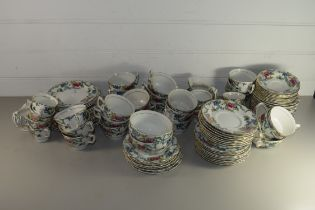 BOOTHS DINNER WARES IN THE FLORADORA PATTERN COMPRSING DINNER PLATES, SIDE PLATES, CUPS AND SAUCERS