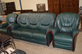 THREE PIECE LEATHER UPHOLSTERED SUITE COMPRISING RECLINER CHAIR, ARMCHAIR AND THREE SEAT SOFA, THE