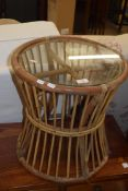 SMALL CIRCULAR GLASS TOP CANE CONSERVATORY TABLE, APPROX 43CM DIAM