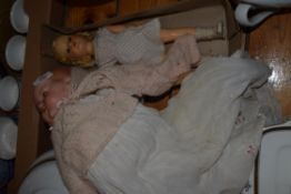 BOX CONTAINING TWO DOLLS, ONE WITH ARMAND MARSEILLE HEAD (A/F)
