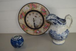 WALL CLOCK WITH BLUE AND WHITE JUG AND FURTHER SMALL JAR WITH PRUNUS DECORATION