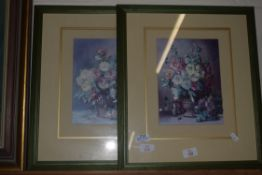 PAIR OF PRINTS OF FLOWERS IN BASKETS IN GREEN WOODEN FRAMES