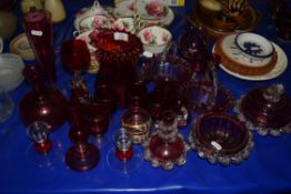CRANBERRY GLASS WARES, JUGS, VASES AND SMALL BASKETS