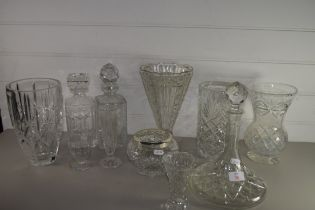 GLASS WARES INCLUDING CUT GLASS SHIPS DECANTER, VASES WITH VARIOUS DESIGNS ETC