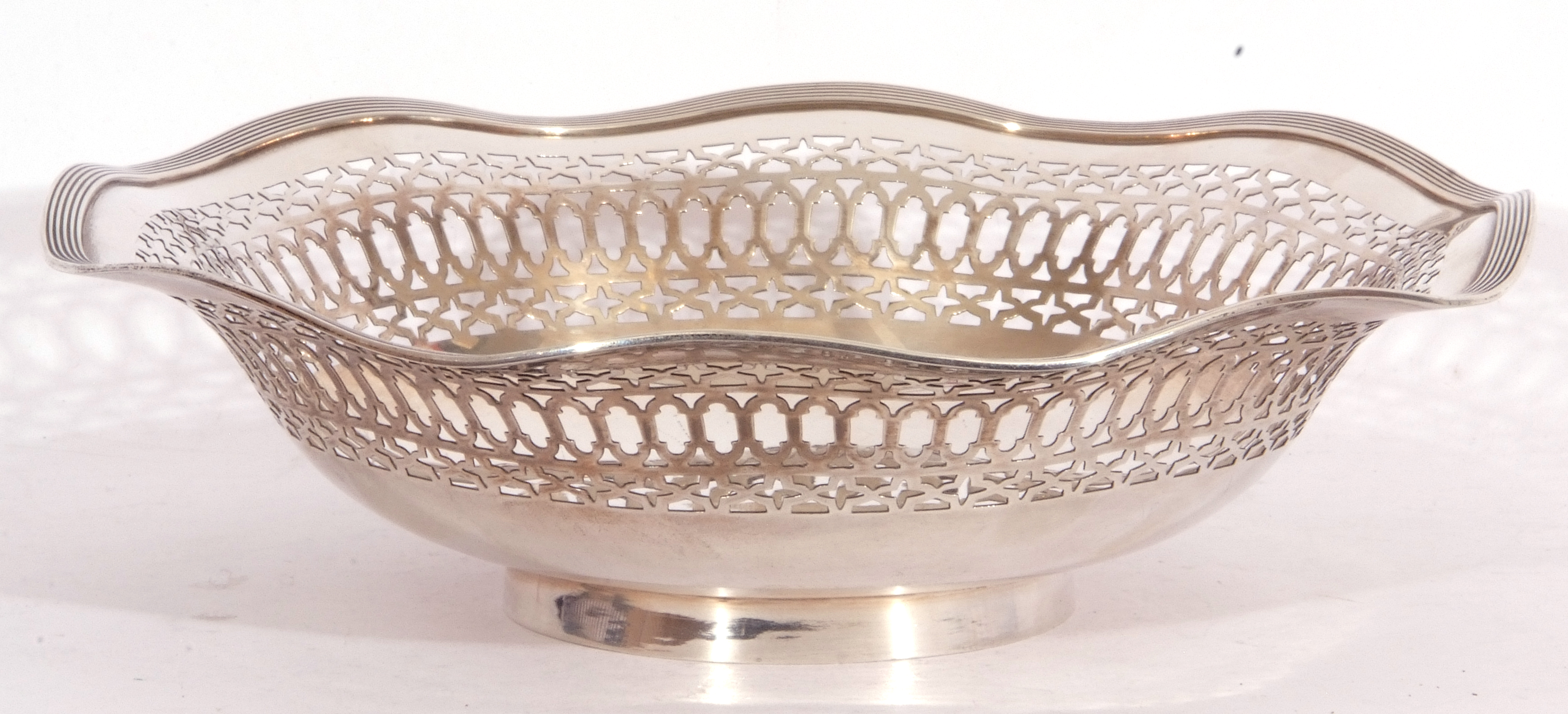 George V silver dish having pierced sides and reeded wavy rim and raised on a circular foot, - Image 3 of 4