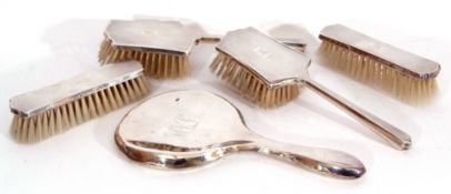Matching silver backed dressing table wares to include two hairbrushes and two clothes brushes,
