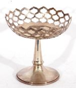 George V silver pedestal dish, the circular pierced bowl on a tapering plain stem and spreading